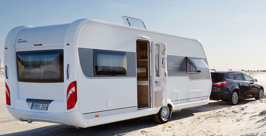 Lightweight travel trailer manufacturers in europe for Slide out motor manufacturers